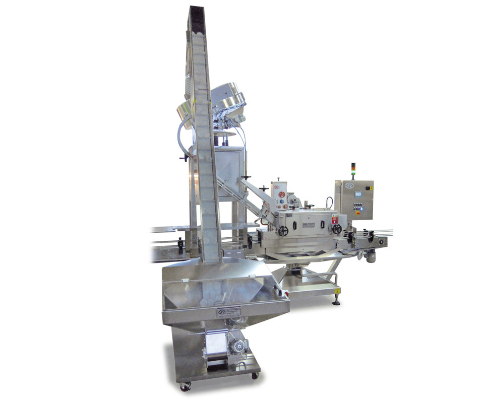 MACHINE SUITABLE FOR CLOSING  GLASS CONTAINERS PRESS-ON PLASTIC COVERS.